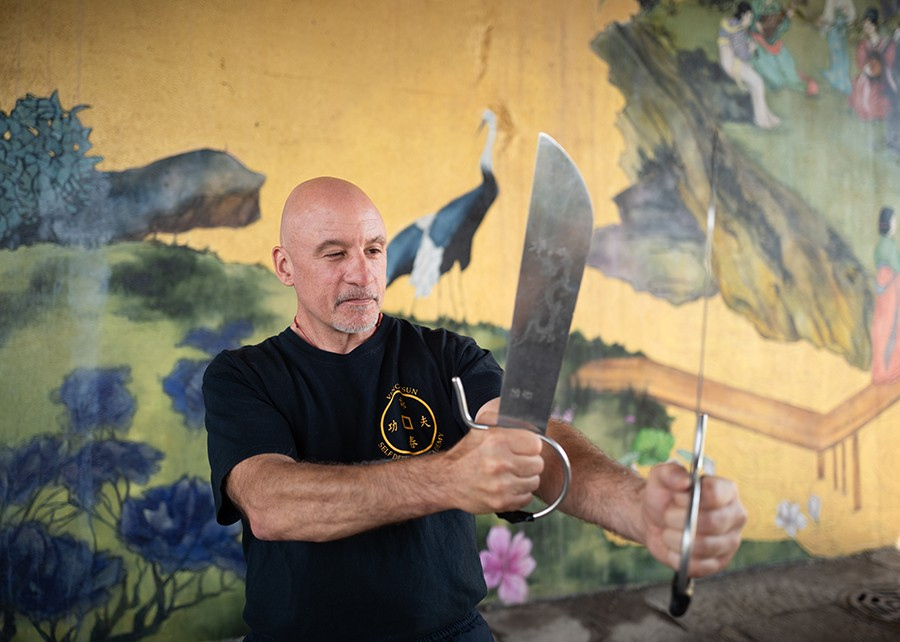 Sifu Matthew Johnson, of the Ving Tsun Self Defense Academy, practices with butterfly knives in Chinatown's Ping Tom Park. - HILLARY JOHNSON FOR CHICAGO READER
