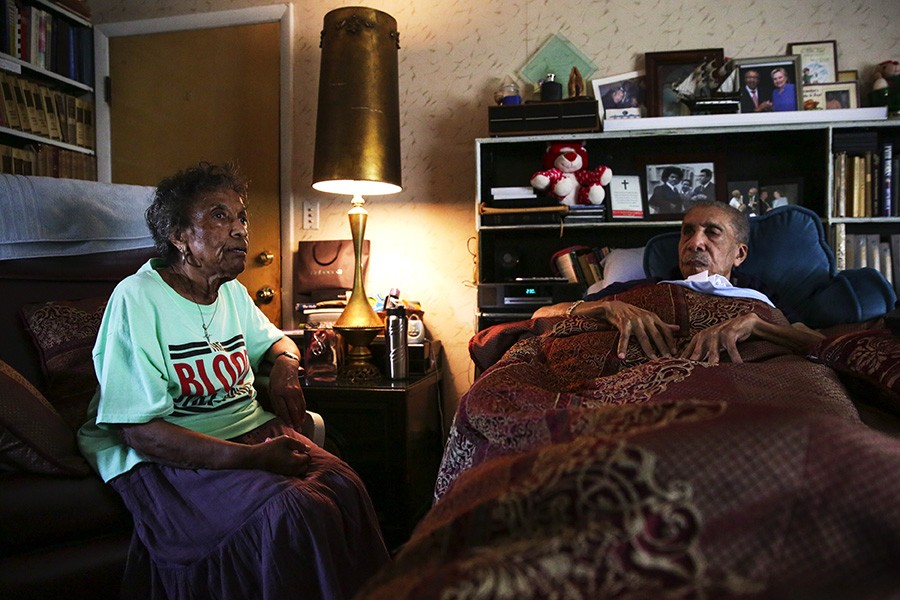 "Mama Lou visits her 94-year-old brother, the Reverend Clay Evans, at his home in Roseland. ""Half of him is me, and half of me is him,"" she says. ""I know we're grown, but I still look up to him as my big brother. I can talk to him about my problems and ask for advice."" - GEOFF STELLFOX FOR CHICAGO READER"
