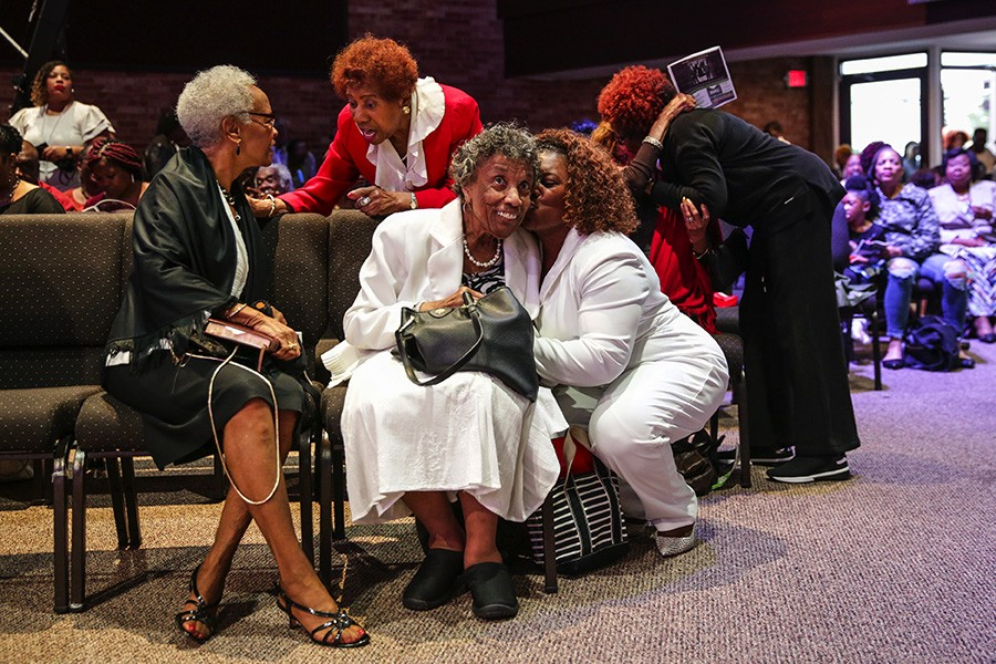 Mama Lou catches up with church members before the 10 AM service at Fellowship Missionary Baptist. - GEOFF STELLFOX FOR CHICAGO READER