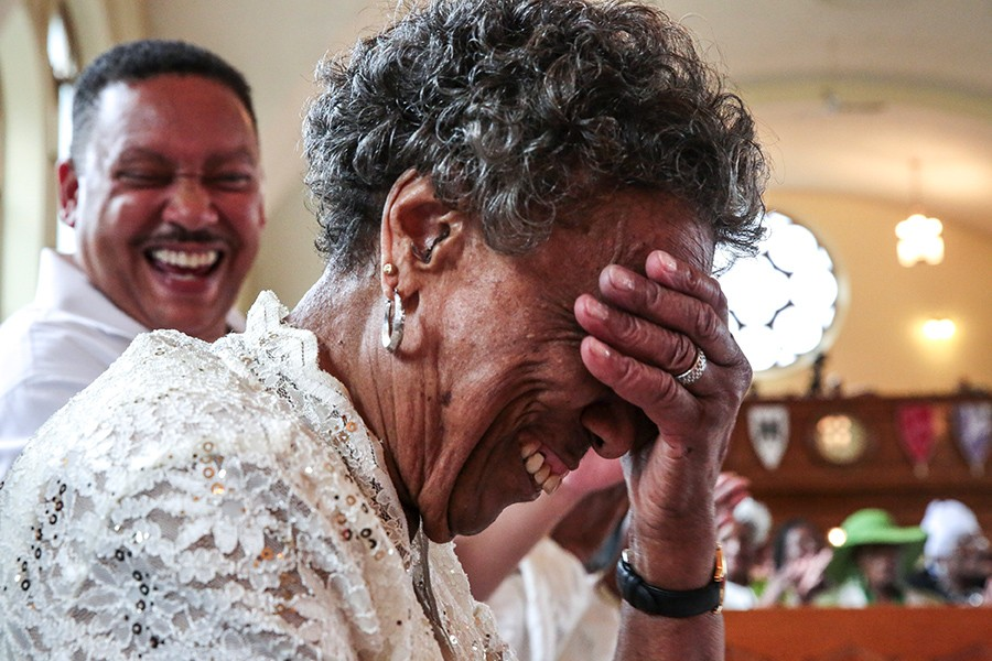Mama Lou laughs in embarrassment during her 89th birthday party this past July at the Greater Cathedral Tabernacle Church of God in Christ. Her birthday celebration brings together churches and choirs from around the city. - GEOFF STELLFOX FOR CHICAGO READER