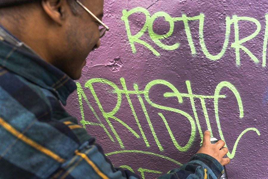 """Roberts leaves his """"Artistic"""" signature on the mural at the Logan Square permission wall. - KIMKOVACIK FOR CHICAGO READER"""