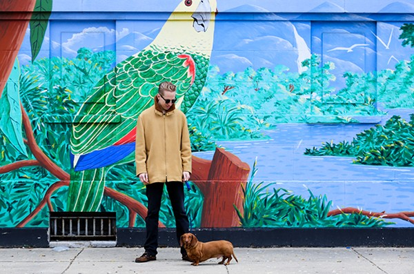 Star Creature Universal Vibrations cofounder Tim Zawada in 2017, with his dog, Tugboat—namesake of the label's Tugboat Editions imprint - OLIVIA OBINEME FOR CHICAGO READER
