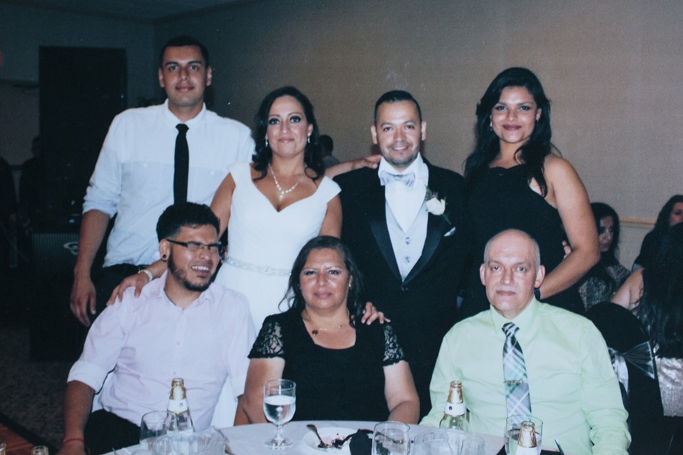 """Jesus Alberto """"Beto"""" Lopez Gutierrez, his aunt Isabel, Victor, sister Mariela, brother Miguel L., and mother  Lourdes and father Miguel, pictured at Isabel and Victor's wedding - COURTESY OF THE LOPEZ GUTIERREZ FAMILY"""