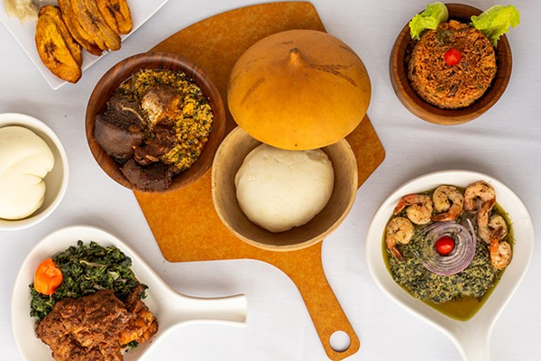 Pounded yam fufu and egusi (center) with goat and fish; around the center clockwise: corn fufu, plantain and bobolo, jollof rice, crevette, and khati khati - ANJALI PINTO FOR CHICAGO READER