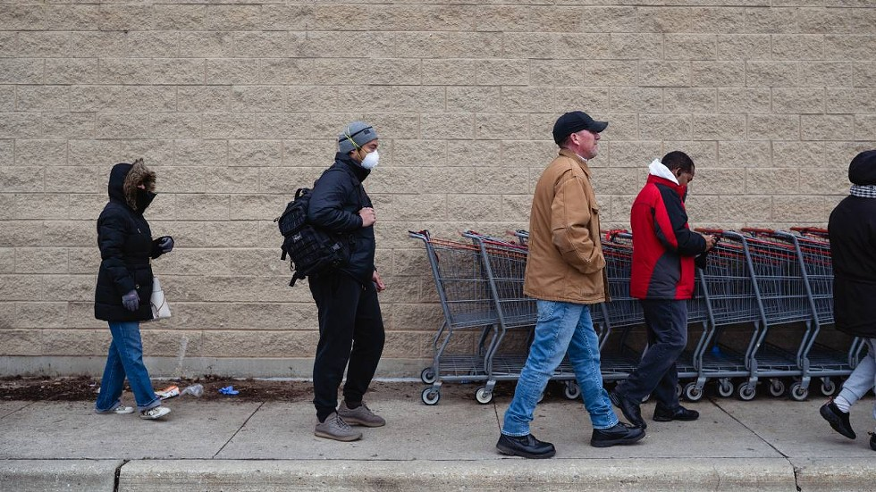 David Mancao wears a mask while lining up for groceries at Costco in Lincolnwood, Illinois. - PAT NABONG
