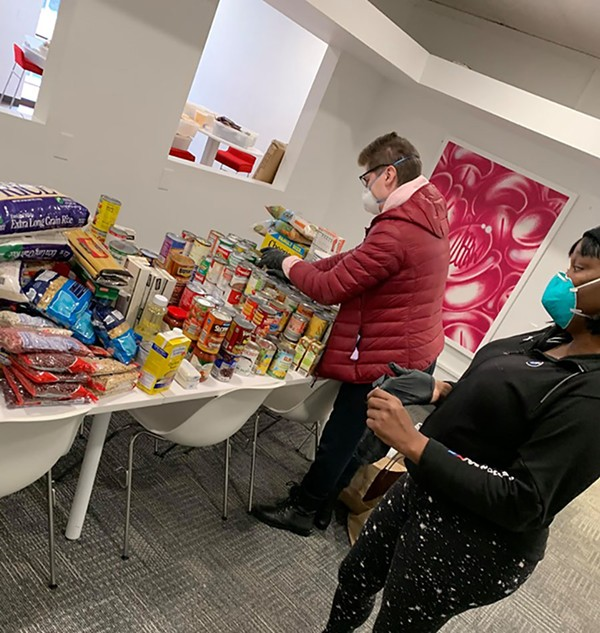 Stephanie Skora and Zahara Bassett of Brave Space Alliance organize food donations at the organization's Hyde Park headquarters. - PHOTO BY BRAVE SPACE ALLIANCE STAFF