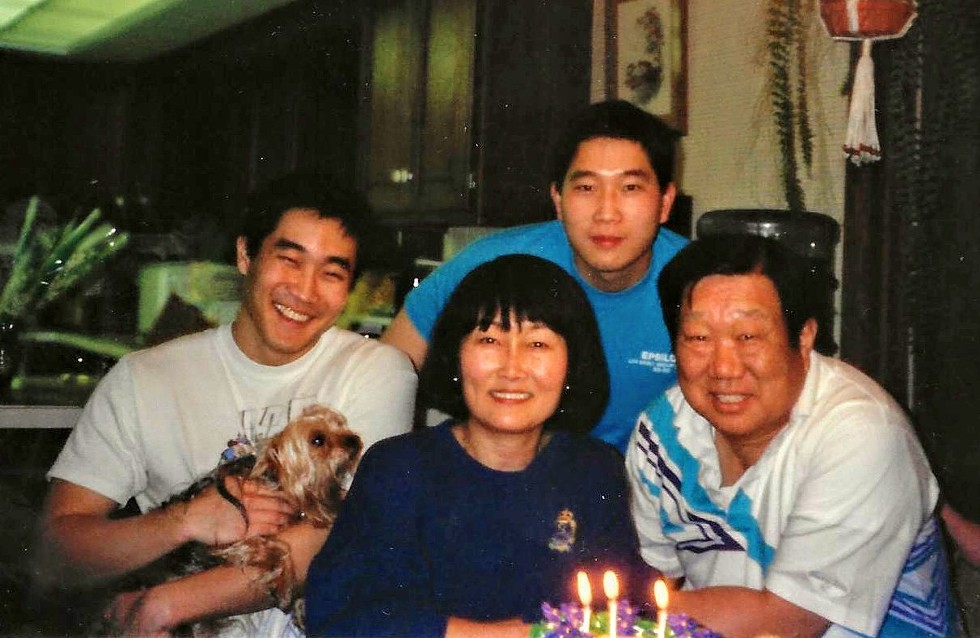 The author (left) with his brother Michael and his late parents Dr. Minjah Kang and Kiwon Kang - ANDY KANG