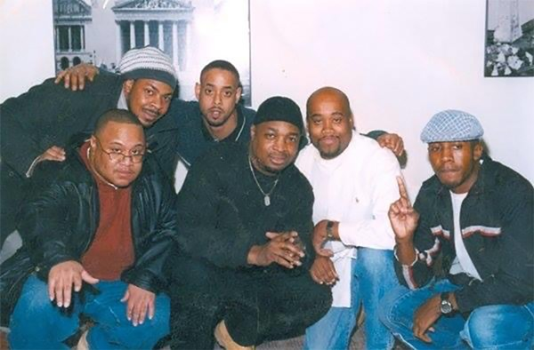 """Jamie """"J. Milla"""" Sevier (third from left) after a Chicago hip-hop panel at the Museum of Science and Industry, with Carrico """"Kingdom Rock"""" Sanders, Bobby """"Massive"""" Ambrose, Chuck D of Public Enemy, Jay Will, and Lavell """"DJ Jihad"""" Watson - COURTESY CARRICO SANDERS"""