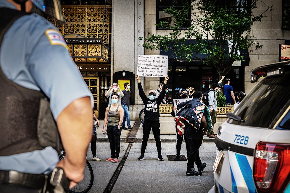 Protesters march in the Loop against police brutality and the murder of George Floyd on May 30. - BROOKE HUMMER