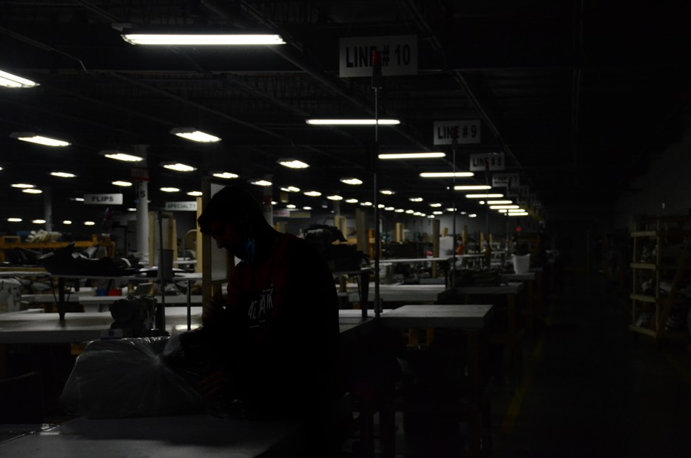 A worker organizes upholstery at a RV manufacturing plant. - LUCAS ROBINSON