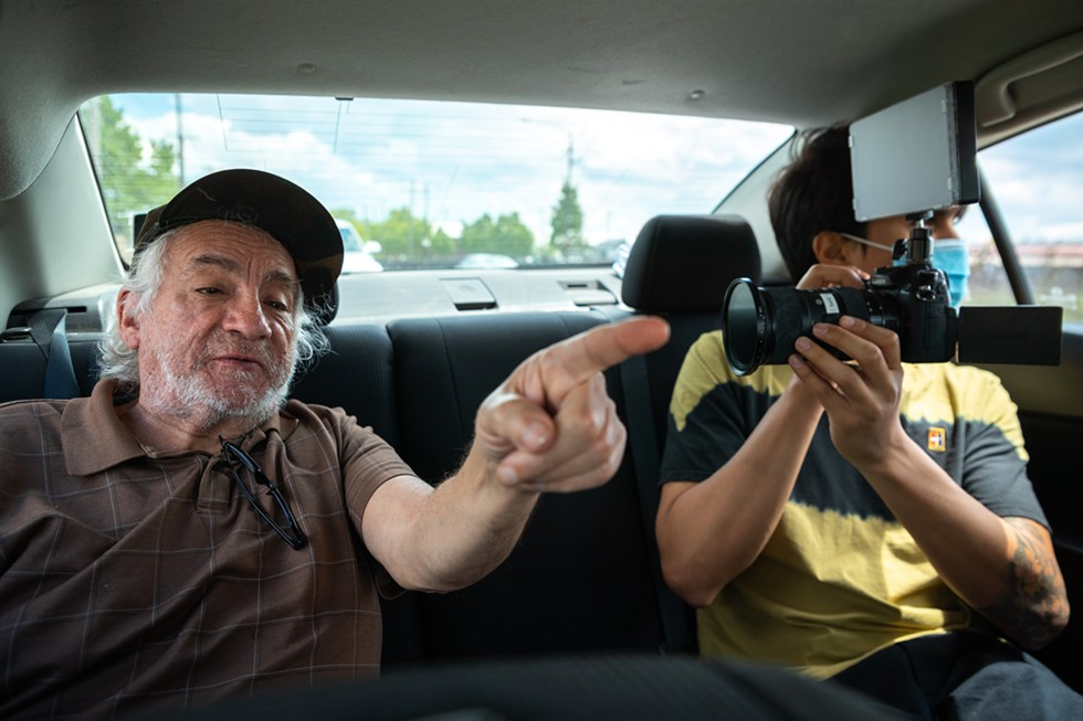 "Videographer, Emmanuel Camacho, riding with  Roger ""Coco"" Gomez. - COURTESY OF STEVEN J. WALSH"