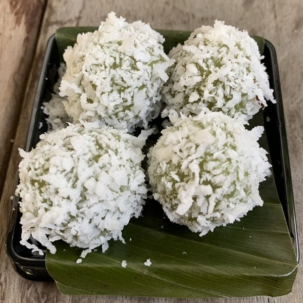 Onde-onde, glutinous rice balls rolled in salted coconut and loaded with an explosion of liquid palm sugar - MIKE SULA
