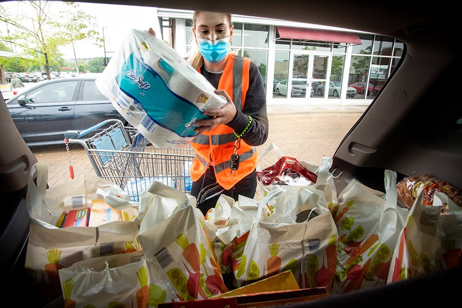 The Scholars Slide By volunteer Korrina Zartler loads groceries for delivery. - MATTHEW GILSON FOR CHICAGO READER