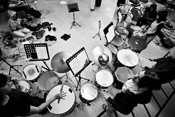 An old photo of Secret Drum Band in rehearsal - MARTIN C. EVANS