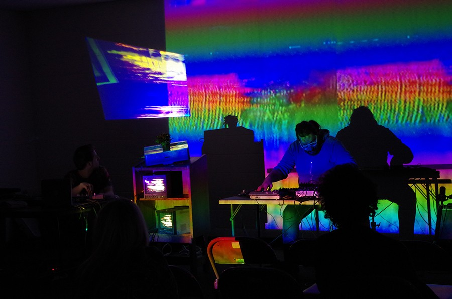 Above: Chicago experimental musicians Jim Jam and Alexander Adams support an April 2018 live performance by Shrine, aka video artist and poet Sara Goodman, at the Jefferson Park branch library. - COURTESY KEITH HELT