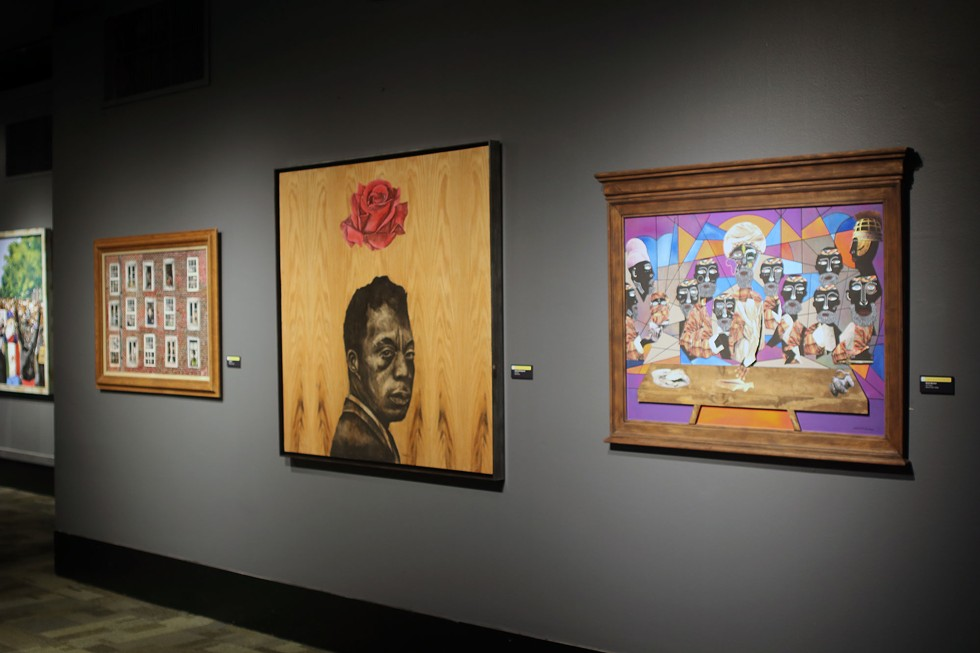 """Last Supper by Onzie Norman, Love Letter by Andrew Hill-Fitzgerald, and Isolation by John Miles line a wall in the 2021 """"Juried Art Exhibition"""" as part of the Museum of Science and Industry's Black Creativity program. - ARIONNE NETTLES"""