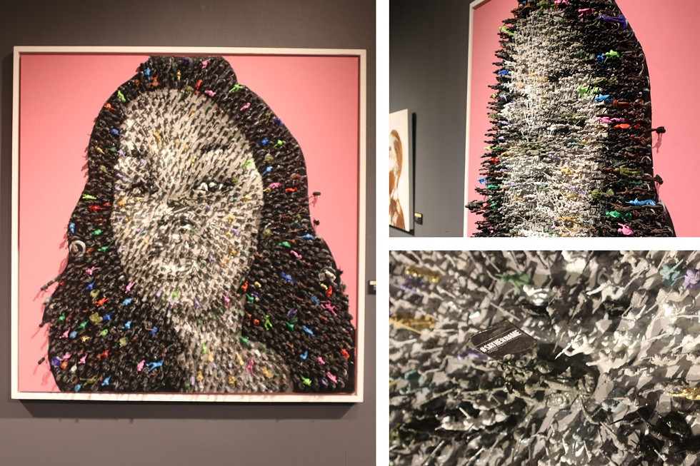 "Say Her Name by Roger Carter is a mixed media piece that utilizes toy army action figures to create a three-dimensional portrait of Breonna Taylor, who Kentucky police fatally shot in her apartment in 2020. Getting close to the piece, visitors can see that the toys are holding up a flag that says, ""#SAYHERNAME."" - ARIONNE NETTLES"
