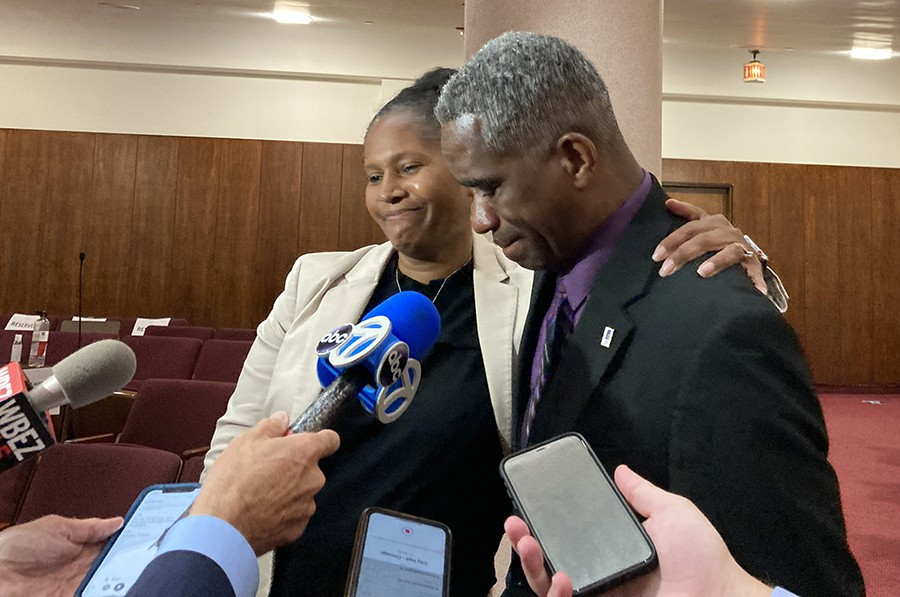 Aldermen Sophia King and David Moore weep while talking with reporters - JOHN GREENFIELD