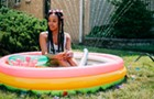 Jamila Woods includes Chicago schoolkids, joyful blackness, and a backyard barbecue in her video for 'LSD'