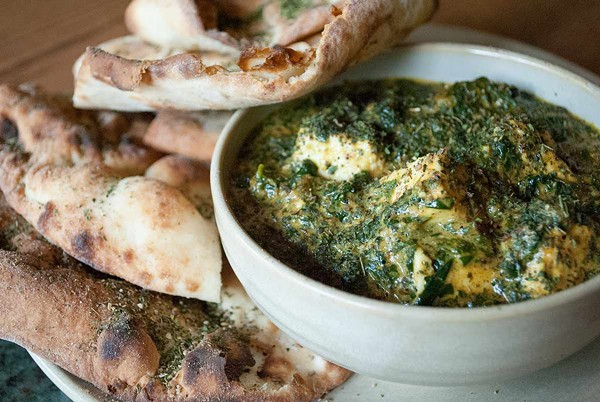 The saag paneer is like an Indian steak-house style creamed spinach.