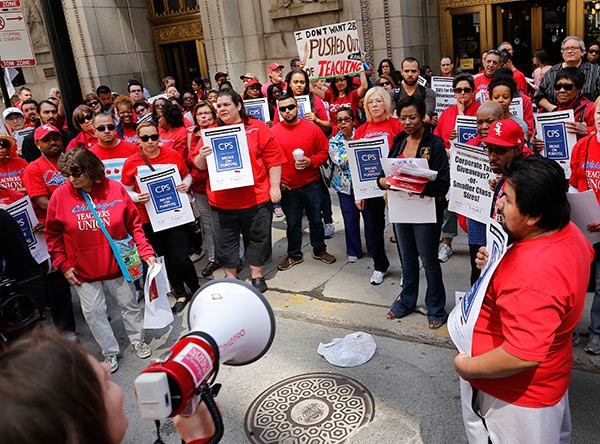 Members of the Chicago Teachers Union demonstrate against proposed cuts to the schools while Mayor Rahm Emanuel plans to borrow more money.
