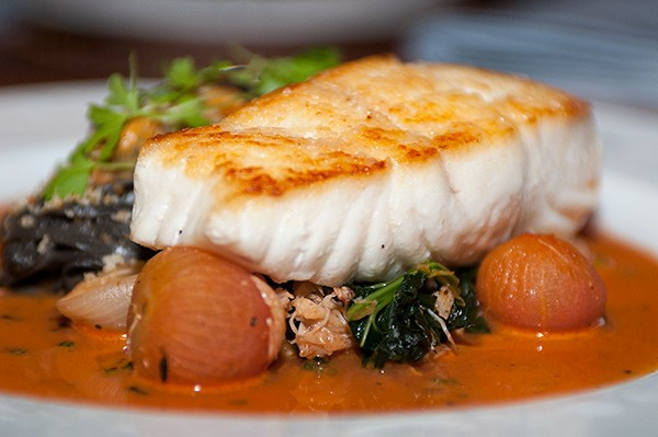 The halibut is poached in a liquid that's made in part with Paul McGee's Bloody Mary mix.