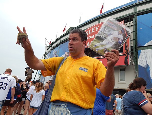 Matt Smerge in action, hawking copies of his Cubs-centric magazine Chicago Baseball.