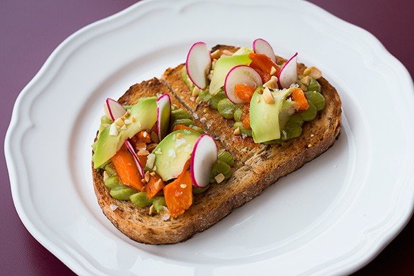 A multigrain slice topped with squiggles of avocado puree, roasted carrots, thinly sliced radishes, and crushed almonds is just one of the options addressing the toast craze.