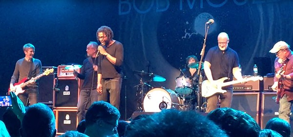 """Che Arthur (third from left) onstage at First Avenue in Minneapolis, singing Prince's """"When You Were Mine"""" with Bob Mould (second from right) and members of the Suicide Commandos"""