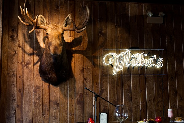 A giant moose head presides over the bar at Millie's.