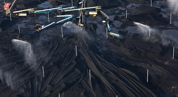 Terry Evans, Petcoke piles with sprinklers at KCBX site on Calumet River, 2014
