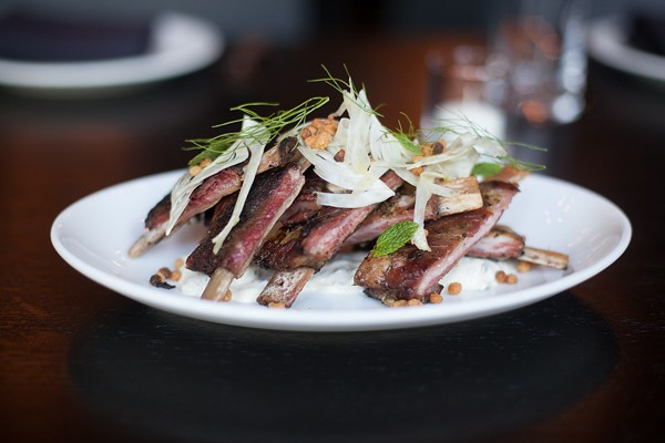 Lamb riblets with an almost pastrami-like quality are showered in shaved fennel and minty yogurt.