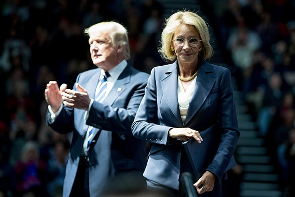 Donald Trump with Betsy DeVos at a rally in Grand Rapids, Michigan, on December 9