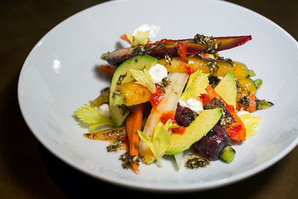 Roasted carrot salad with pickled celery and avocado, dressed with za'atar and harissa