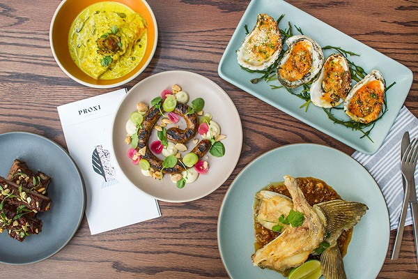 A selection of Proxi dishes, from left: lamb ribs; cobia fillet in a mild, gently sweet sauce scented by curry leaf and stained by tumeric; merguez sausage; oysters with butter and ssamjang; halibut collars