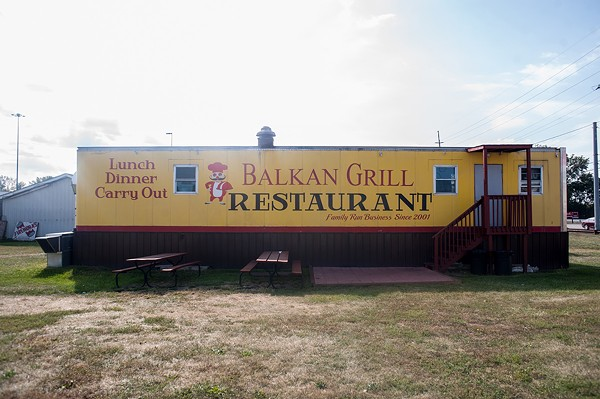 Balkan Grill Company is parked near a traffic-heavy highway junction, adjacent to two competing truck stops.
