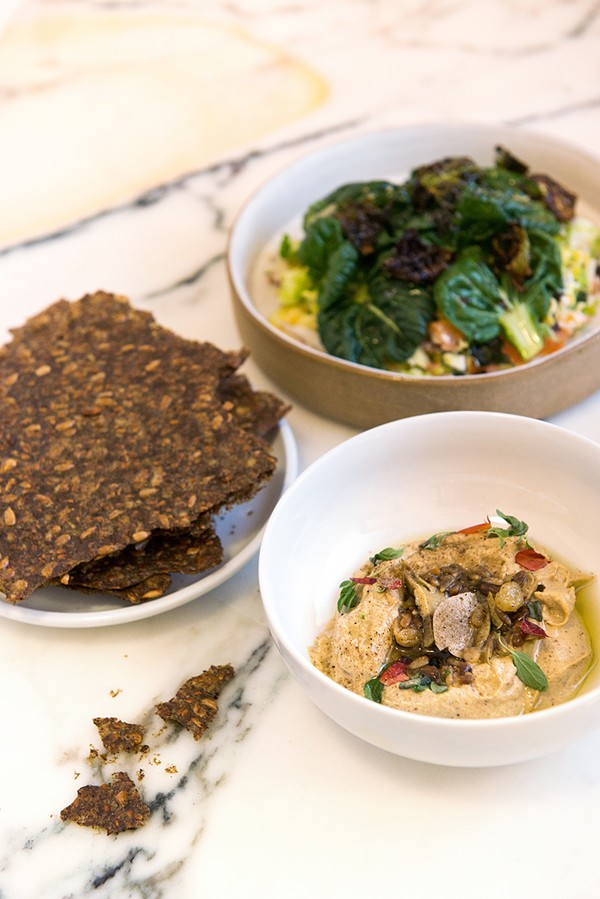 Flaxseed crackers, brussels sprouts and whitefish with candied poppy seeds and orange vinaigrette, sunflower hummus