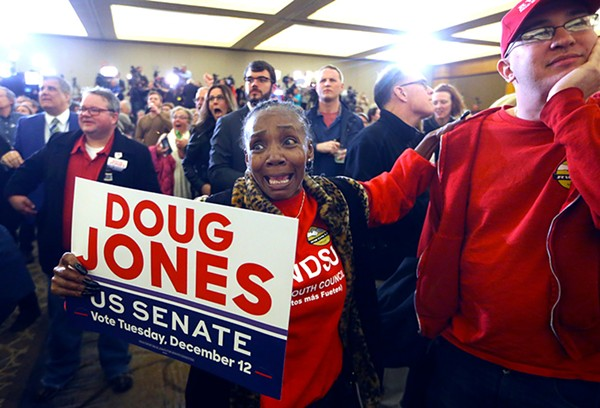A Doug Jones supporter at an election-night party in Birmingham