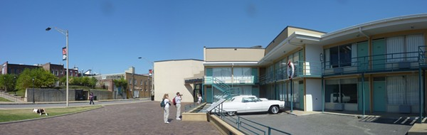 Wide view of the Lorraine Motel and the boarding house from which James Earl Ray fired the fatal shot from a second-floor bathroom window (to the left of the pole).