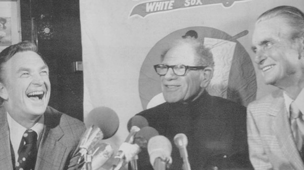 Bill Veeck, center, at a 1975 press conferencing announcing he's just bought the White Sox again (image added 2018)