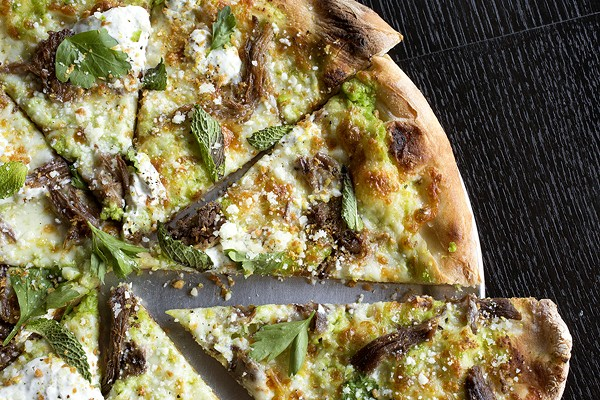 Braised lamb pizza with ricotta and pea puree