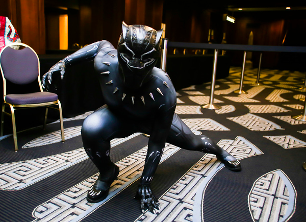 A Wakandacon 2018 attendee in costume as the Black Panther.
