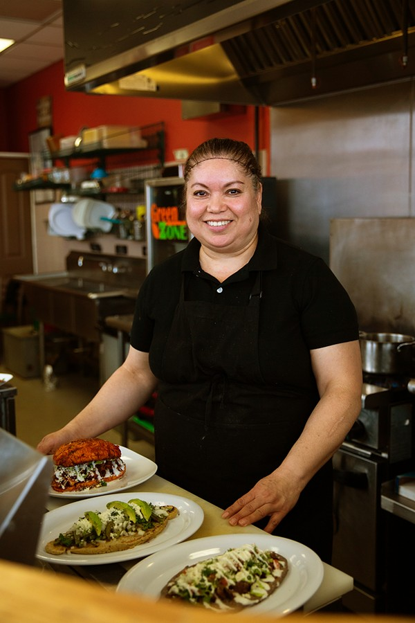 Bertha Garcia with her tlacoyos and a pambazo
