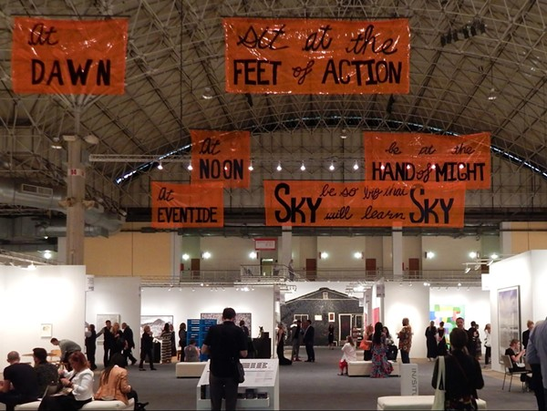 Sky Will Learn Sky, 2018 by Cauleen Smith hangs over the show floor at EXPO Chicago 2019