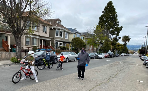 A family hangs out on a Slow Street in Oakland.