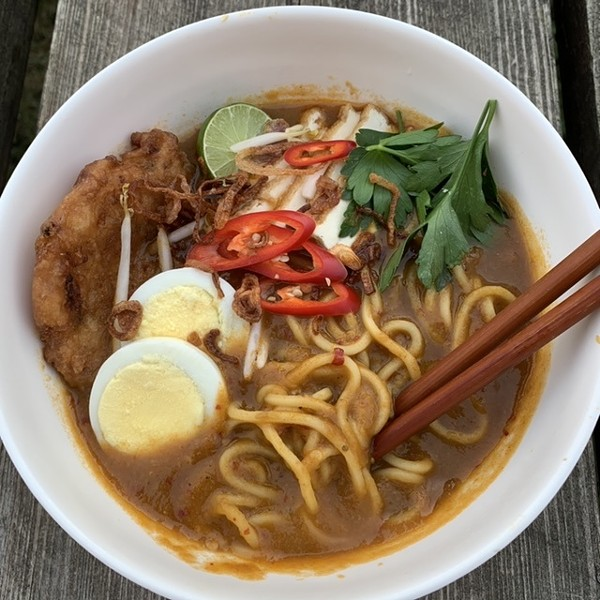 Mee rebus jawa, a dish native to Java, featuring a spicy sweet-potato-and-prawn gravy, with bean sprouts, fried tofu, prawn fritters, and a hard-boiled egg