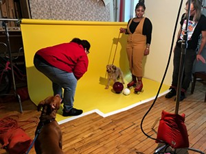 Sports & Rec model Patti needs the encouragement of her dog bestie Ray to prep for the shoot. Janaya holds Ray to set up the shot, while photo assistant Brian Gladkowski is on standby. - JAMIE RAMSAY FOR CHICAGO READER
