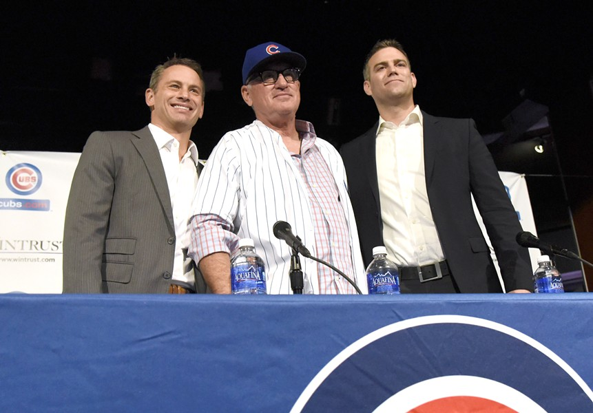 Cubs' general manager Jed Hoyer (left) and team president Theo Epstein (right)  introduced Maddon as Cubs manager last October. Maddon owns a camper he named Eddie, where he played host to Hoyer and Epstein before he was hired. - DAVID BANKS/GETTY IMAGES