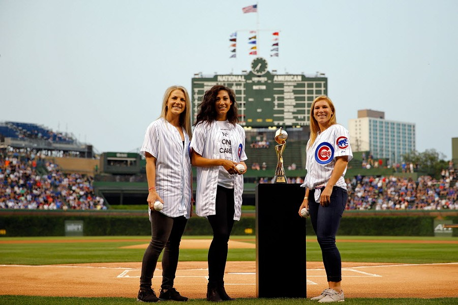 The Red Stars' Julie Johnston, Christen Press, and Lori Chalupny pose with the Womens' World Cup at Wrigley in August - JON DURR/GETTY