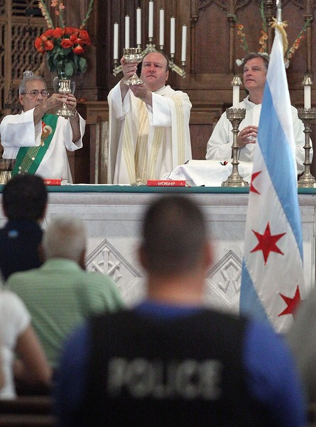 Father Dan Brandt says mass twice a month for Chicago police officers and their families at churches around the city. - KEVIN TANAKA